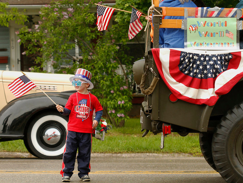 . Jacob Webster, 4, of West Bend waits for the Memorial Day parade to begin in West Bend on Monday, May 27, 2013.  (AP Photo/The Daily News, John Ehlke)