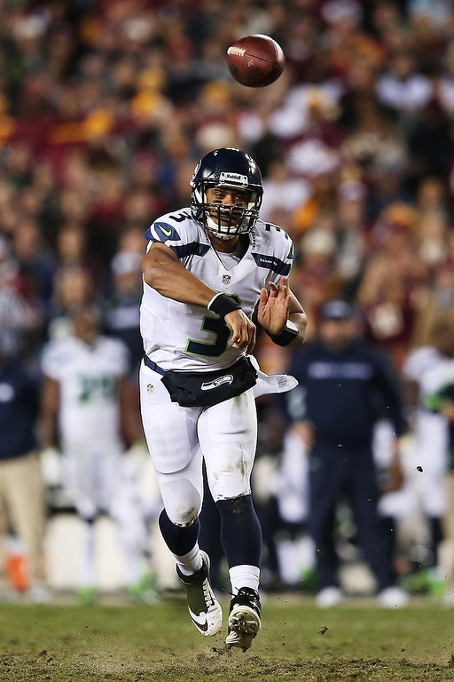 . Russell Wilson #3 of the Seattle Seahawks throws the ball in the second quarter of their NFC Wild Card Playoff Game against the Washington Redskins at FedExField on January 6, 2013 in Landover, Maryland.  (Photo by Win McNamee/Getty Images)