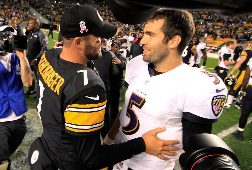 . Pittsburgh Steelers quarterback Ben Roethlisberger (7) greets Baltimore Ravens quarterback Joe Flacco after an NFL football game on Sunday, Oct. 20, 2013 in Pittsburgh. The Steelers won 19-16. (AP Photo/Gene Puskar)