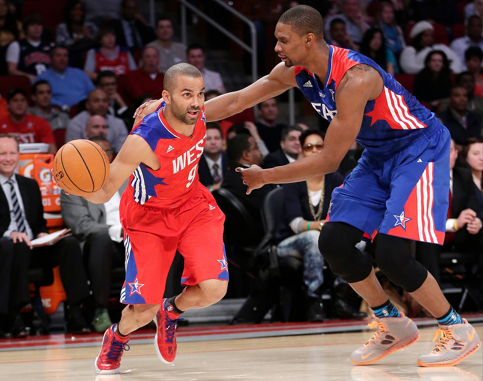 . West Team\'s Tony Parker from France, of the San Antonio Spurs drives against East Team\'s Chris Bosh of the Miami Heat during the first half of the NBA All-Star basketball game Sunday, Feb. 17, 2013, in Houston. (AP Photo/Eric Gay)
