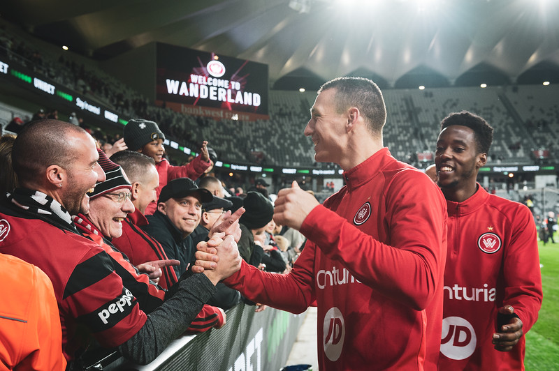 SYDNEY, AUSTRALIA - JULY 22: Mitchell Duke of the Wanderers greets fans following their first ever game at Bankwest Stadium against and Leeds United. Bankwest Stadium on July 22, 2019 in Sydney, Australia.
