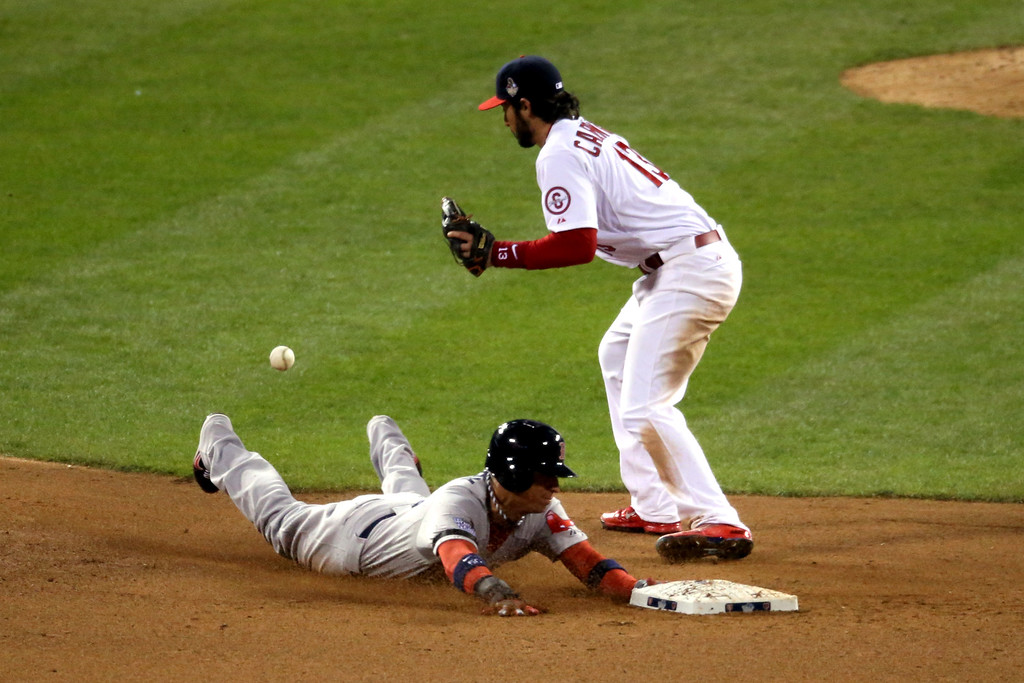 . Quintin Berry #50 of the Boston Red Sox steals second base against Matt Carpenter #13 of the St. Louis Cardinals in the top of the eighth inning during Game Four of the 2013 World Series at Busch Stadium on October 27, 2013 in St Louis, Missouri.  (Photo by Rob Carr/Getty Images)