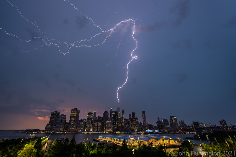 NEW YORK, NY/USA, July 6, 2021: Lightning strikes the World Trade Center as a severe-warned thunderstorm passes over the city.