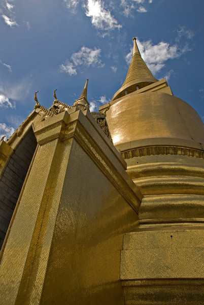 Looking up golden pagoda and stupa Wat Phra Kaew - Bangkok, Thailand