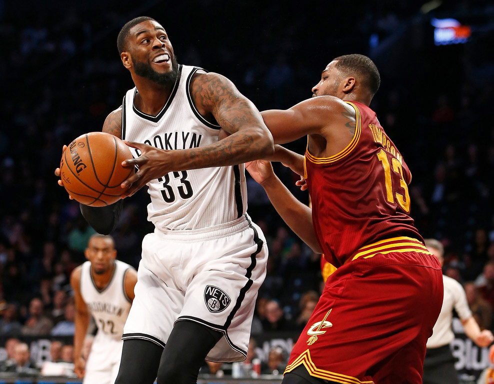 . Brooklyn Nets forward Willie Reed (33) looks for an opening with Cleveland Cavaliers center Tristan Thompson (13) defending in the second half of an NBA basketball game, Wednesday, Jan. 20, 2016, in New York. The Cavaliers defeated the Nets 91-78. (AP Photo/Kathy Willens)
