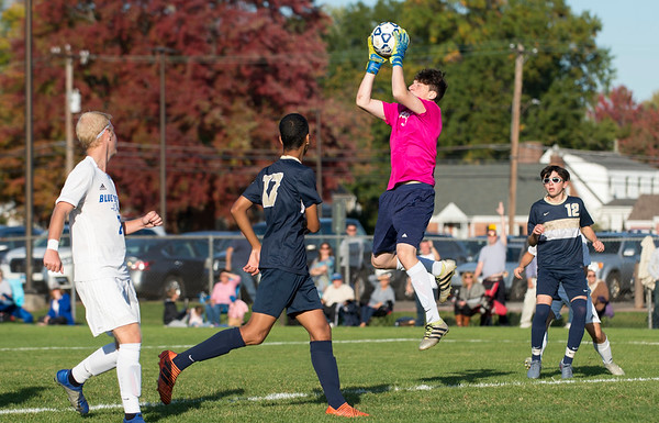 10/15/19 Wesley Bunnell | StaffrrPlainville boys soccer defeated host Newington 2-1 on Tuesday afternoon. Newington GK Nick Cox (0).