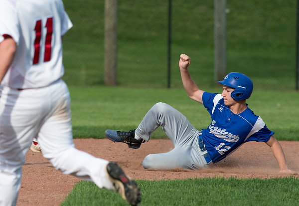 05/6/19 Wesley Bunnell | Staff Berlin baseball defeated Bristol Eastern at Sage Park on Tuesday afternoon. Ryan Fradette (12) slides into second base.