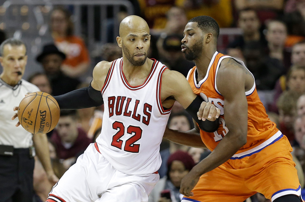 . Chicago Bulls\' Taj Gibson (22) drives against Cleveland Cavaliers\' Tristan Thompson (13) in the first half of an NBA basketball game, Wednesday, Jan. 4, 2017, in Cleveland. (AP Photo/Tony Dejak)
