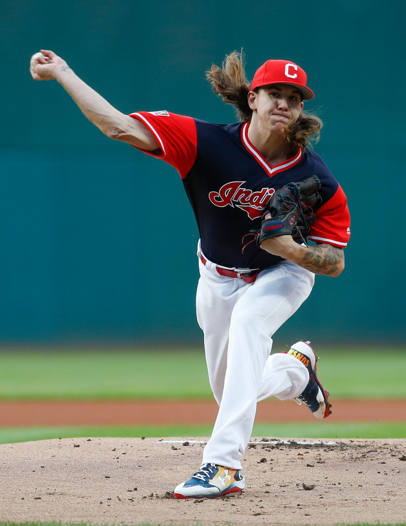 . Cleveland Indians starting pitcher Mike Clevinger delivers against the Kansas City Royals during the first inning in a baseball game, Saturday, Aug. 26, 2017, in Cleveland. (AP Photo/Ron Schwane)