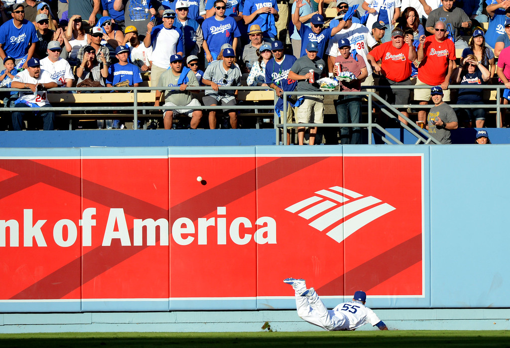 . A fly ball hit bt Braves Evan Gattis bounces off the wall allowing the Justin Upton to score during game 3 of the NLDS at Dodger Stadium Sunday, October 6, 2013. (Photo by David Crane/Los Angeles Daily News)