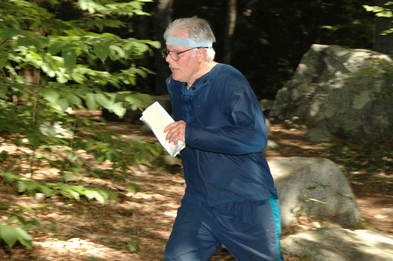 Roger Underwood runs for the finish