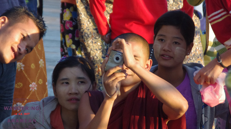 A monk playing tourist as well.