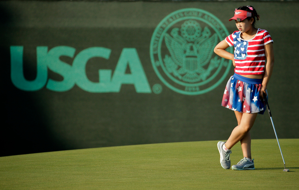 . Lucy Li waits to putt on the 13th green during the first round of the U.S. Women\'s Open golf tournament in Pinehurst, N.C., Thursday, June 19, 2014. (AP Photo/Chuck Burton)