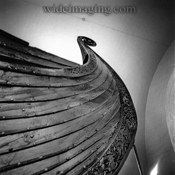 The Oseberg Viking ship (circa 800) stern post rhymes with the curved ceilings of the museum, by Arnstein Arneberg (1926).