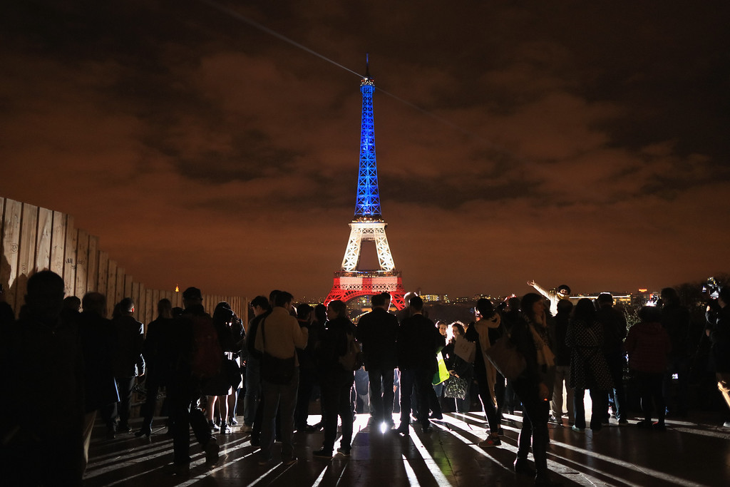 . The Eiffel Tower is illuminated in Red, White and Blue in honor of the victims of Friday\'s terrorist attacks on November 16, 2015 in Paris, France. Countries across Europe joined France today to observe a one minute-silence in an expression of solidarity with the victims of the terrorist attacks, which left at least 129 people dead and hundreds more injured.  (Photo by Christopher Furlong/Getty Images)