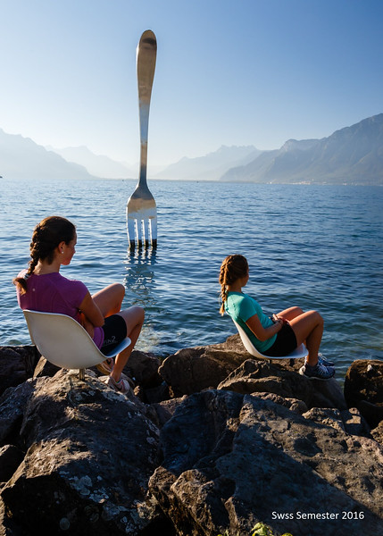Peyton and Penelope enjoying the fork sculpture in Lac Leman