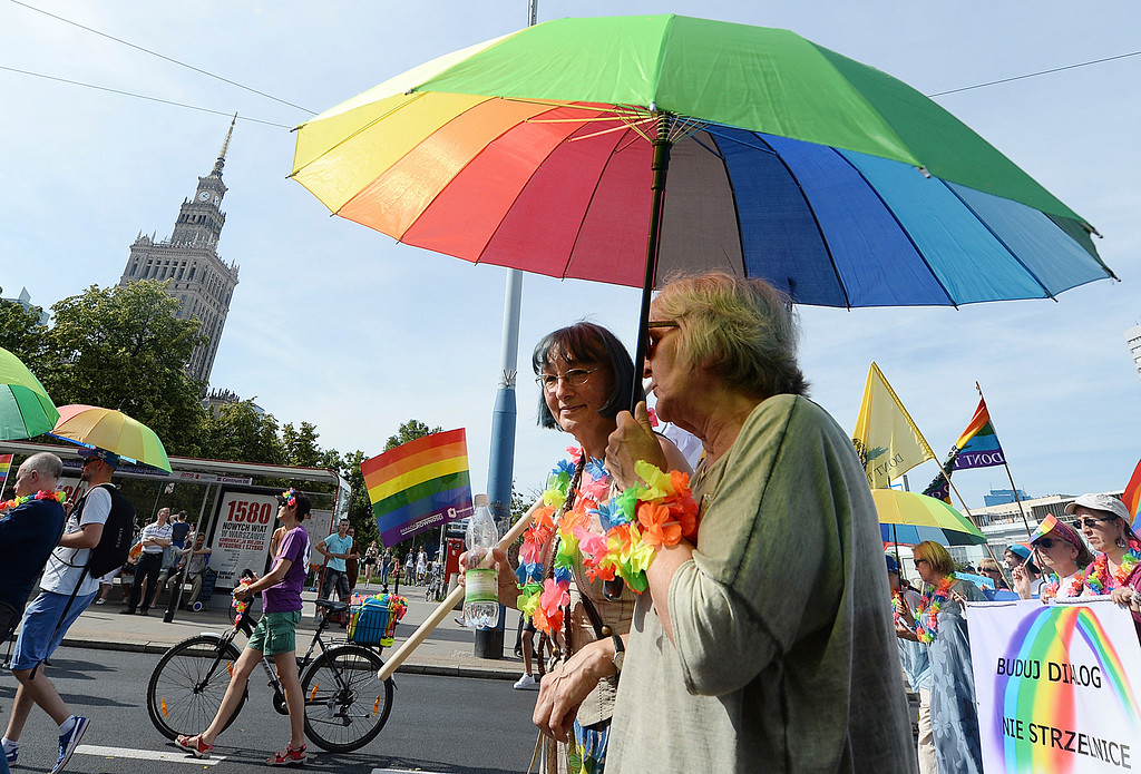 . People take part in a Gay Pride parade in Warsaw, Poland, Saturday, June 9, 2018. The pride celebrations come as LGBT activists say a conservative turn in Poland is only motivating them to fight harder for their rights, even though their hopes of seeing same-sex marriage legalized has no chance now in the country. (AP Photo/Czarek Sokolowski)