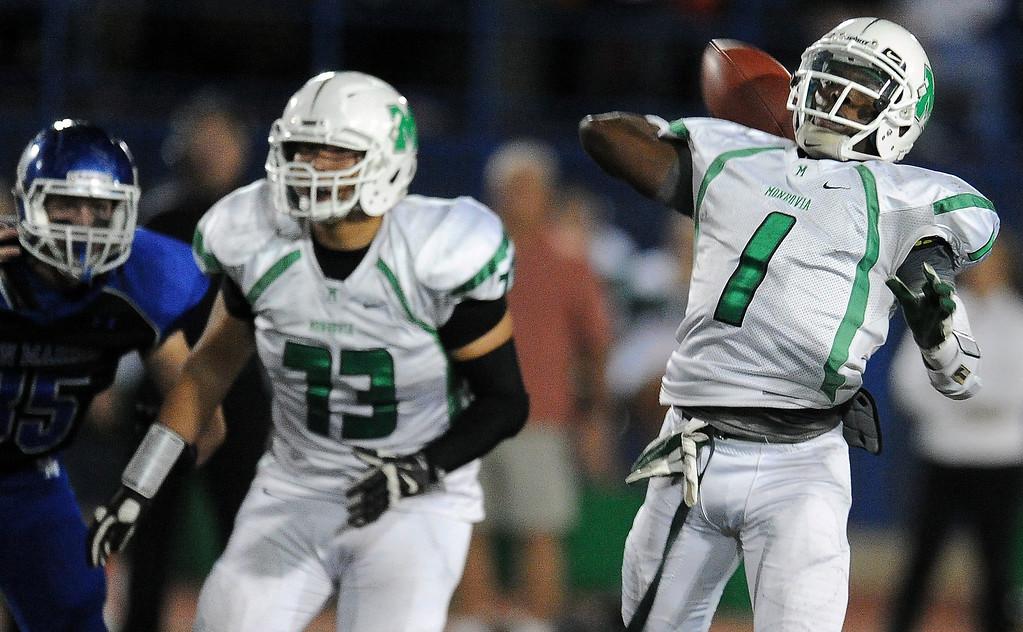 . Monrovia quarterback Deshawn Potts (C) (1) passes against San Marino in the first half of a prep football game at Monrovia High School in Monrovia, Calif., on Friday, Nov. 8, 2013.    (Keith Birmingham Pasadena Star-News)