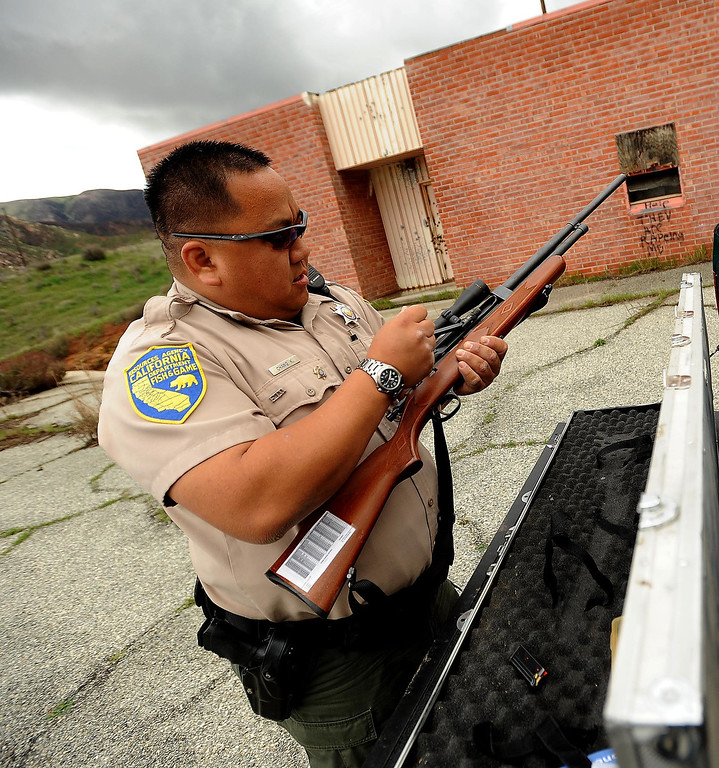 . California Department of Fish and Wildlife Warden Kyle Chang displays his animal dart rifle in the San Jacinto Wildlife Area in Hemet March 8, 2013.  GABRIEL LUIS ACOSTA/STAFF PHOTOGRAPHER.