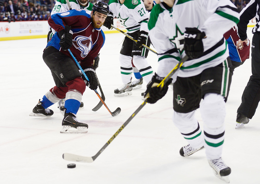 . Colorado Avalanche center Ryan O\'Reilly (90) watches as Dallas Stars defenseman John Klingberg (3) gets away with the puck after it slid between his legs during the first period Saturday, February 14, 2015 at the Pepsi Center in Denver, Colorado. (Photo By Brent Lewis/The Denver Post)
