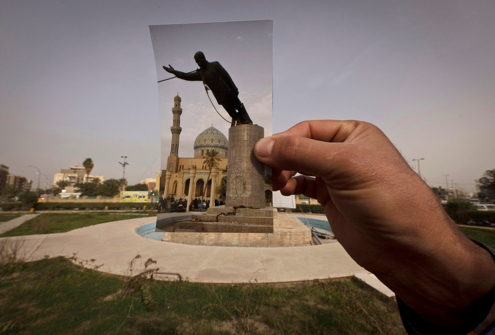 . Firdous Square at the site of a photo of the statue of Saddam Hussein as it is pulled down by U.S. forces and Iraqis taken by Associated Press photographer Jerome Delay on April 9, 2003. Ten years ago on live television, U.S. Marines memorably hauled down a Soviet-style statue of Saddam, symbolically ending his rule. Today, that pedestal in central Baghdad stands empty. Bent iron beams sprout from the top, and posters of anti-American Shiite cleric Muqtada al-Sadr in military fatigues are pasted on the sides. Photo taken on March 13, 2013. (AP Photo/Maya Alleruzzo)