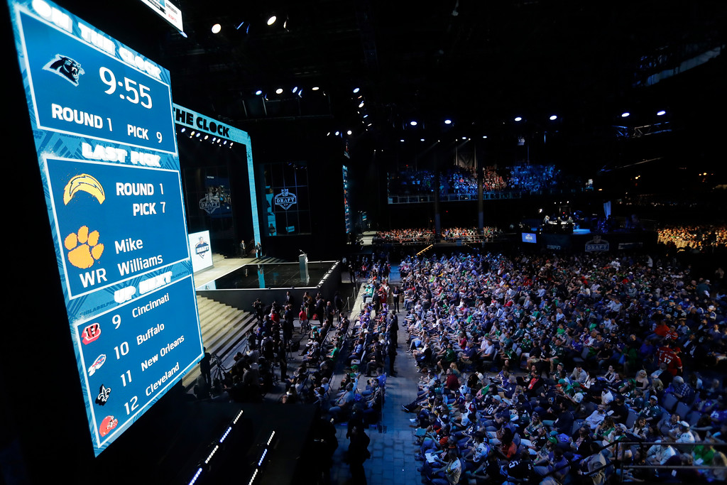 . Fans watch as the Carolina Panthers are on the clock for their selection during the first round of the 2017 NFL football draft, Thursday, April 27, 2017, in Philadelphia. (AP Photo/Julio Cortez)