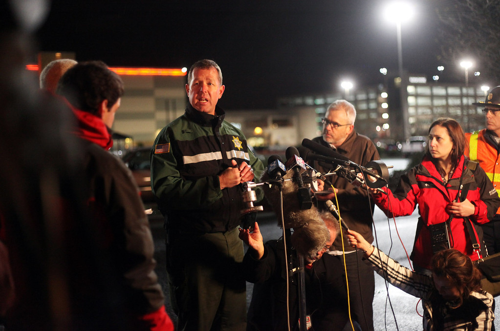 . Clackamas County Sheriffs Sgt. Adam Phillips speaks during a news conference outside the Clackamas Town Center in Portland, Ore., Tuesday, Dec. 11, 2012. A gunman opened fire in the suburban Portland shopping mall Tuesday, killing two people and wounding another as people were doing their Christmas shopping, authorities said. (AP Photo/Statesman-Journal, Thomas Patterson)