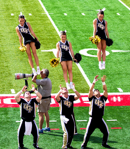 The UCF Cheerleaders celebrate, then dismount.