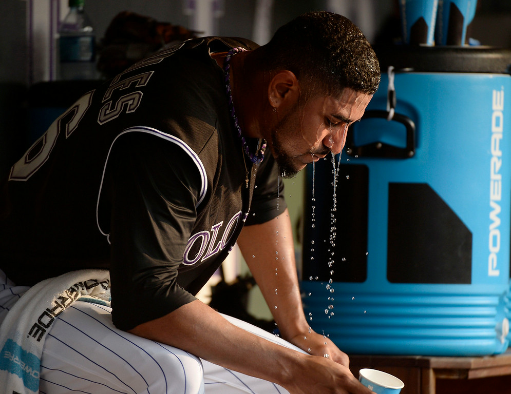 . Colorado Rockies starting pitcher Franklin Morales (56) cools off in the dugout during the first inning against the San Diego Padres July 8, 2014 at Coors Field. (Photo by John Leyba/The Denver Post)