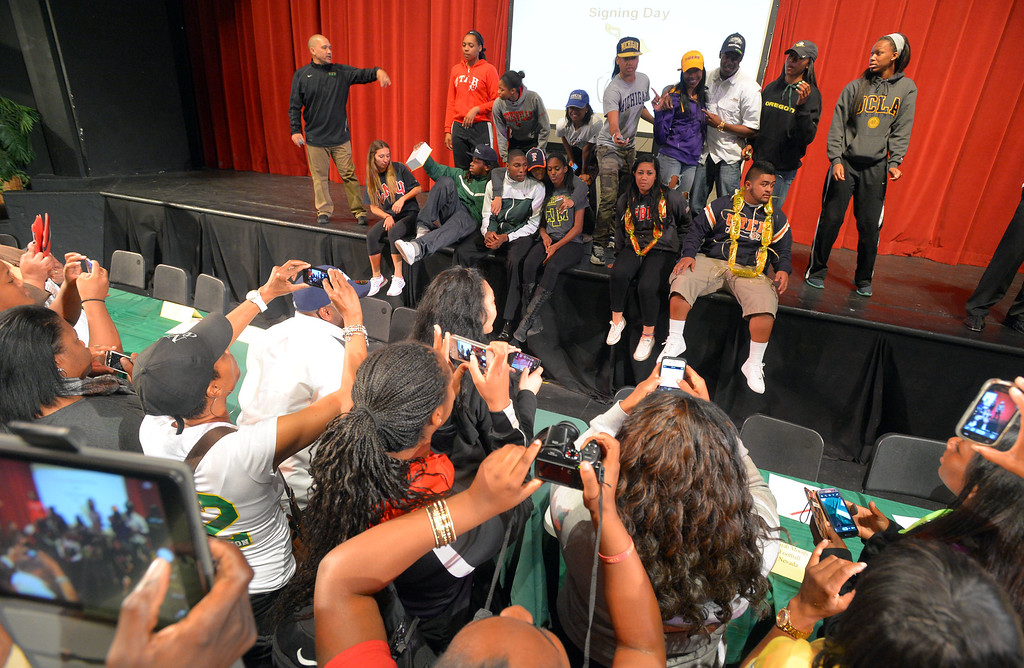 . 18 students athletes at Long Beach Poly pose for a group photo after signing their national letters of intent to play athletics at 4-year universities during a ceremony in Long Beach, CA on Wednesday, February 5, 2014. (Photo by Scott Varley, Daily Breeze)