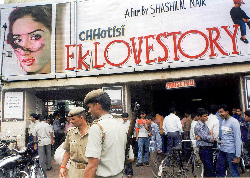 . LUCKNOW, INDIA:  Police stand guard outside the entrance of a theatre showing Bollywood film \'Ek Chotsi Love Story\' (A Small Love Story) in Lucknow, 06 September 2002. The right-wing Hindu party Shiv Sena forcibly stopped the screening of the movie in a Bombay theater. The lead actress, Manisha Koirala, has objected to nude scenes in the film. SEBASTIAN D\'SOUZA/AFP/Getty Images