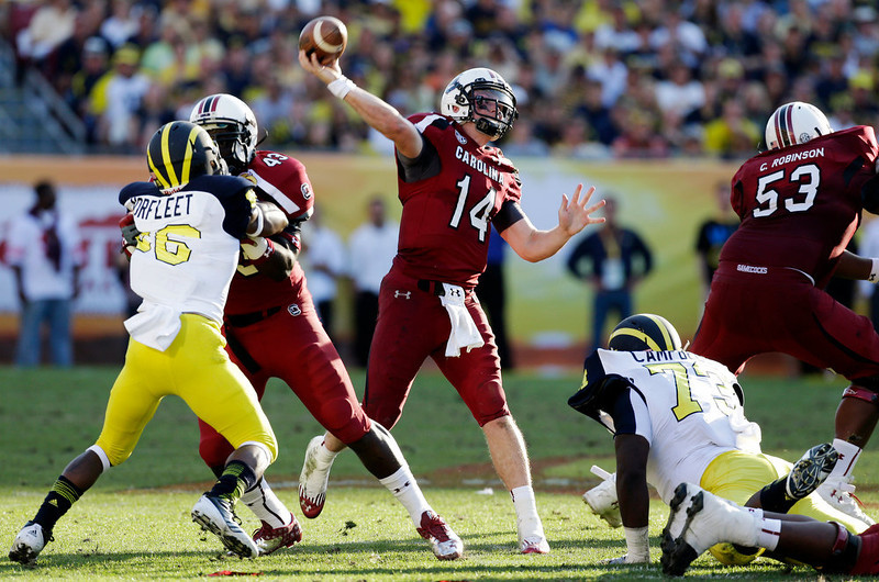 . South Carolina quarterback Connor Shaw (14) throws a touchdown pass to wide receiver Ace Sanders during the second half of the Outback Bowl NCAA college football game against Michigan, Tuesday, Jan. 1, 2013, in Tampa, Fla. South Carolina won 33-28. (AP Photo/Chris O\'Meara)