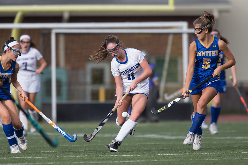 Southington's Jenna Sheehan pushes up field between defenders Monday during a qualifying round in Class L of the CIAC Tournament at Fontana Field in Southington November 6, 2017 | Justin Weekes / For the Record-Journal