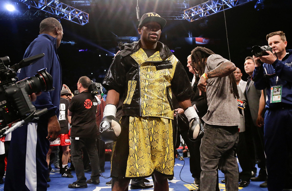 . Floyd Mayweather Jr. steps into the ring to defend his WBC welterweight title against Robert Guerrero, Saturday, May 4, 2013, in Las Vegas. (AP Photo/Rick Bowmer)