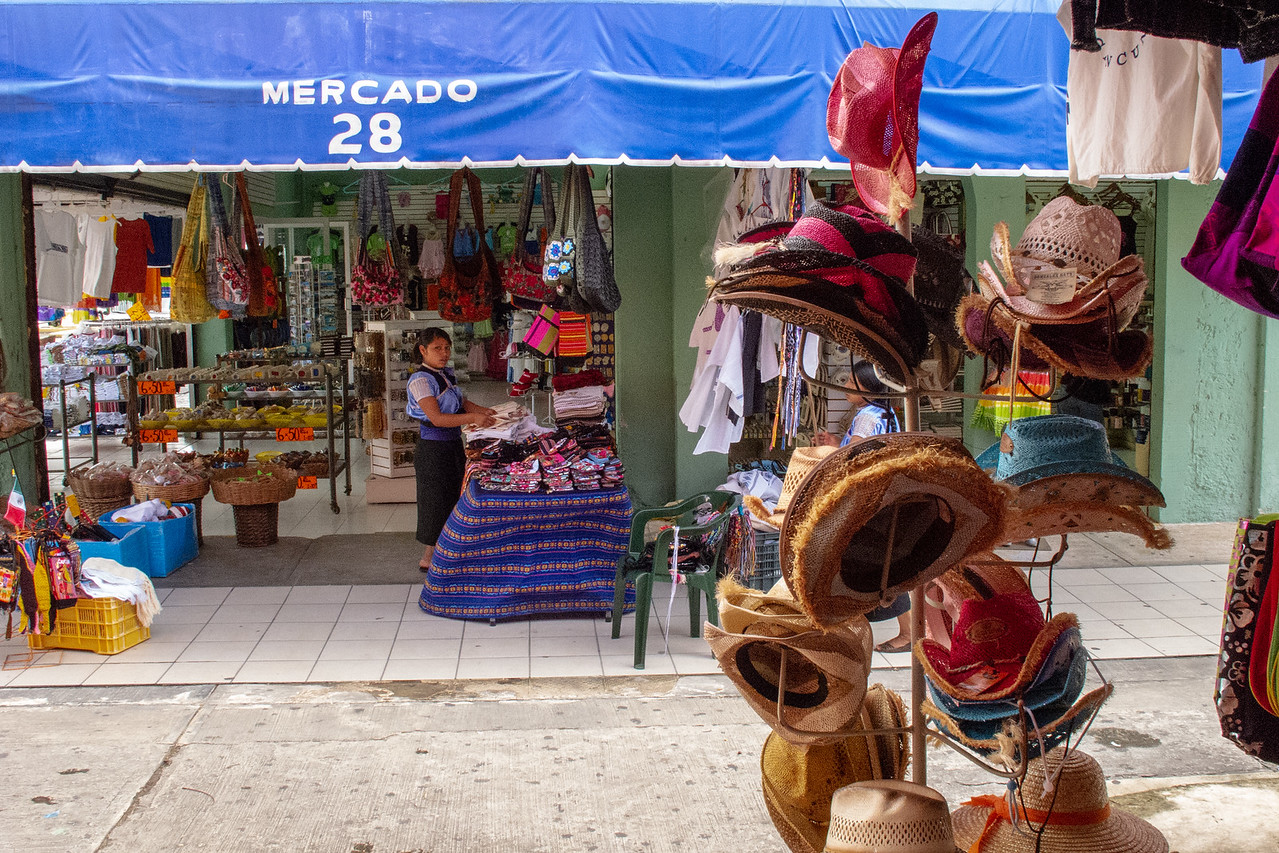 Vendor in Mayan Clothes Working at Market 28 in Cancun