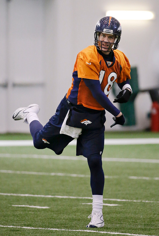 . Denver Broncos quarterback Peyton Manning passes during practice Thursday, Jan. 30, 2014, in Florham Park, N.J. The Broncos are scheduled to play the Seattle Seahawks in the NFL Super Bowl XLVIII football game Sunday, Feb. 2, in East Rutherford, N.J. (AP Photo)