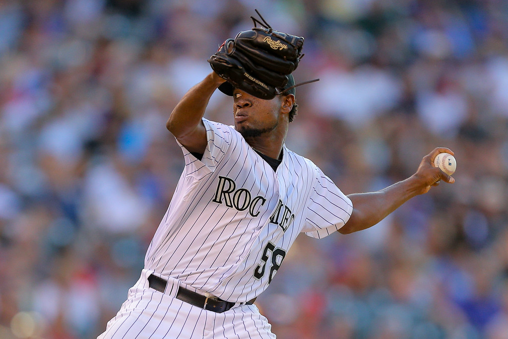 . DENVER, CO - JULY 22:  Starting pitcher Yohan Flande #58 of the Colorado Rockies delivers to home plate during the third inning against the Washington Nationals at Coors Field on July 22, 2014 in Denver, Colorado.  (Photo by Justin Edmonds/Getty Images)