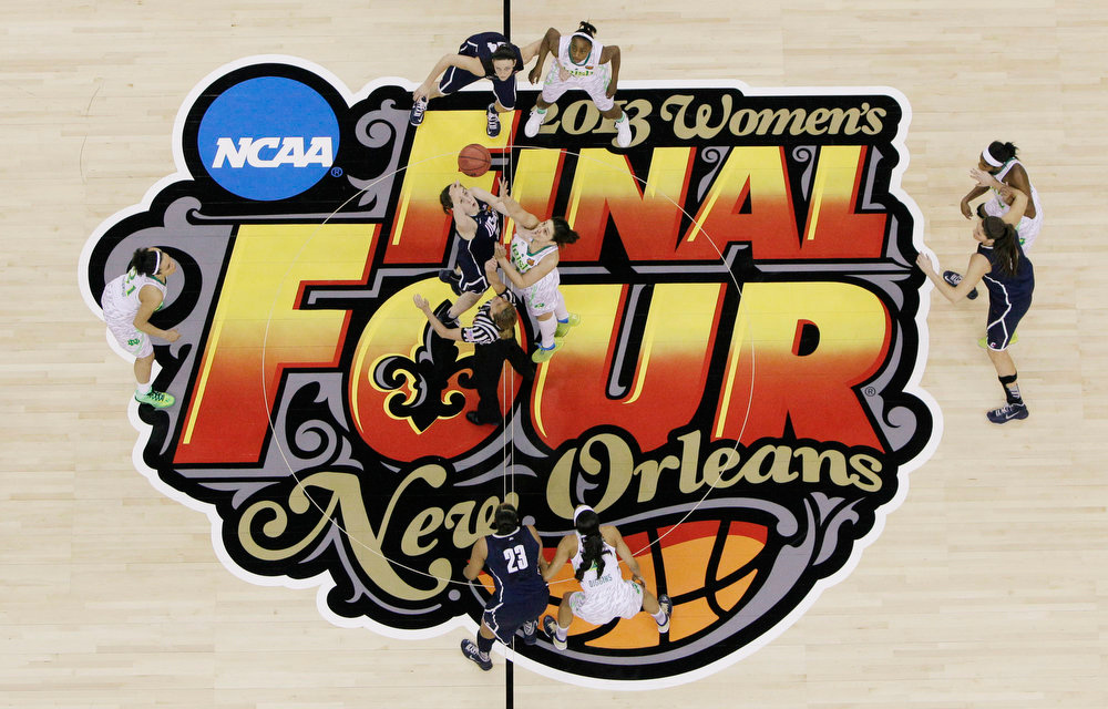 . Connecticut forward Breanna Stewart (30) and Notre Dame forward Natalie Achonwa (11) tip the ball to begin the first half of a women\'s NCAA Final Four college basketball tournament semifinal, Sunday, April 7, 2013, in New Orleans. (AP Photo/Dave Martin)