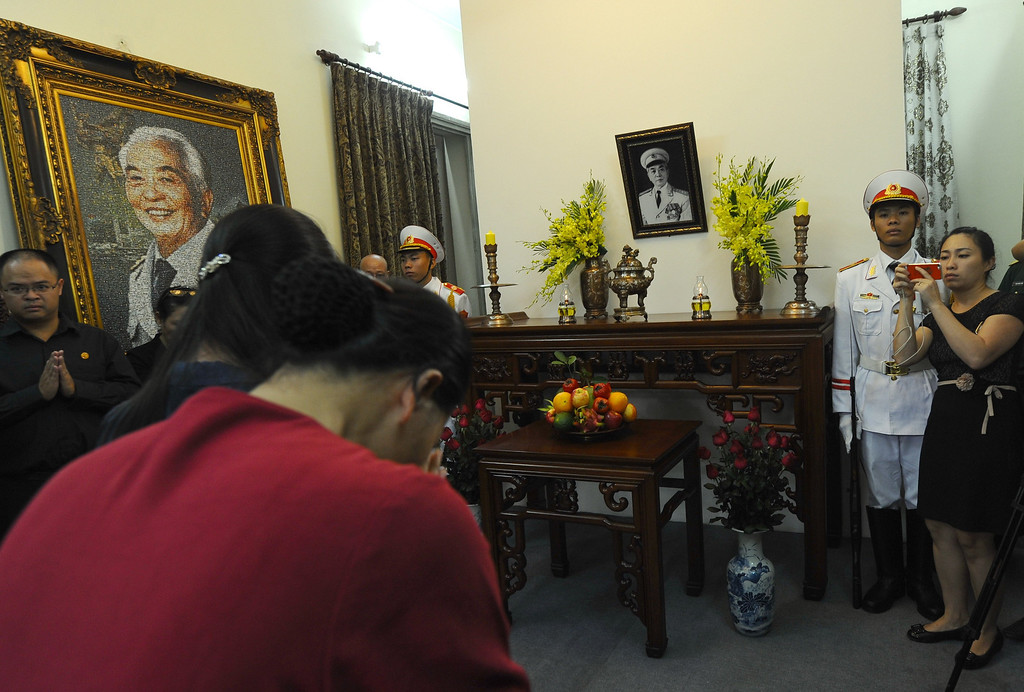 . Two women bow down to pay homage to late General Vo Nguyen Giapa in front of a portrait of the general that was set up inside his residence in Hanoi where thousands of people flocked to pay last tribute to the national independence hero in Hanoi on October 6, 2013. Vietnam announced plans to hold a national funeral for independence hero General Vo Nguyen Giap in the first official statement on the death of the ruthless but brilliant military strategist. HOANG DINH NAM/AFP/Getty Images