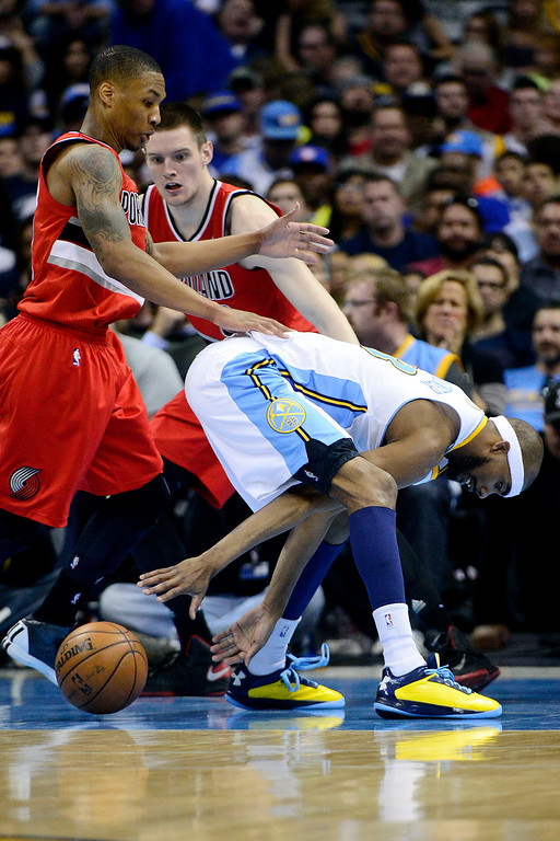 . DENVER, CO - APRIL 14: Corey Brewer (13) of the Denver Nuggets loses control of the ball as Damian Lillard (0) of the Portland Trail Blazers defends during the second half of action. The Denver Nuggets defeat the Portland Trail Blazers 118-109 at the Pepsi Center. (Photo by AAron Ontiveroz/The Denver Post)