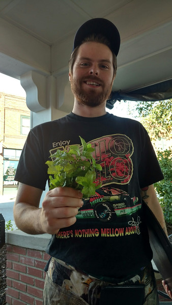 our waiter and the fresh gathered mint for our mojitos at the Universal Joint - thanks Joyce for this pix