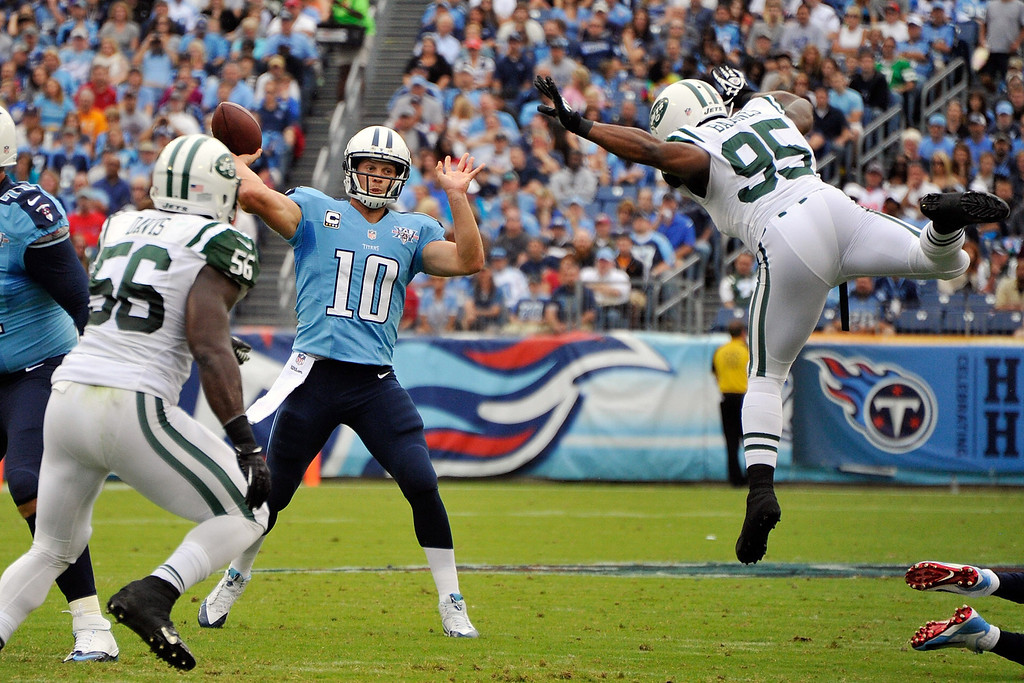 . NASHVILLE, TN - SEPTEMBER 29: Antwan Barnes #95 of the New York Jets jumps to block a pass by Jake Locker #10 of the Tennessee Titans at LP Field on September 29, 2013 in Nashville, Tennessee.  (Photo by Frederick Breedon/Getty Images)