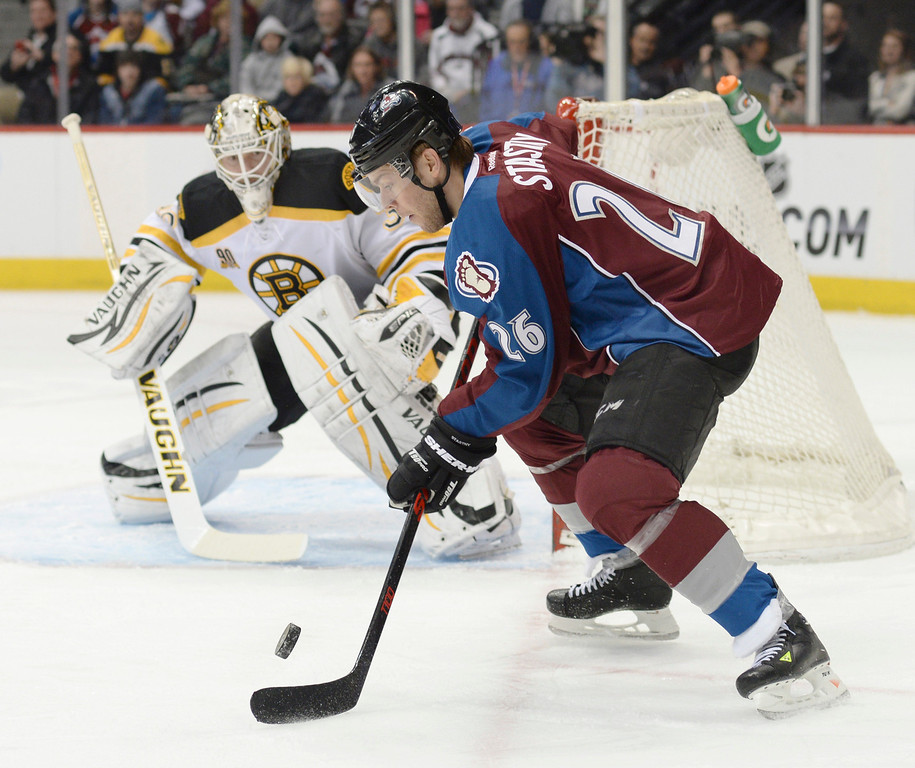 . Colorado center Paul Stastny readied a shot for Boston goaltender Chad Johnson in the first period. The Colorado Avalanche hosted the Boston Bruins at the Pepsi Center Friday night, March 21, 2014. (Photo by Karl Gehring/The Denver Post)