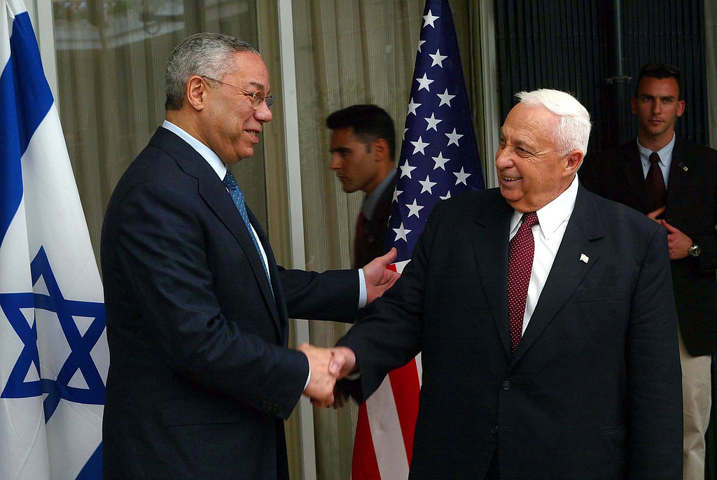 . United States Secretary of State Colin Powell shakes hands with Israeli Prime Minister Ariel Sharon May 11, 2003 at the start fo their meeting at Sharon\'s official residence in Jerusalem. (Photo by David Silverman/Getty Images)