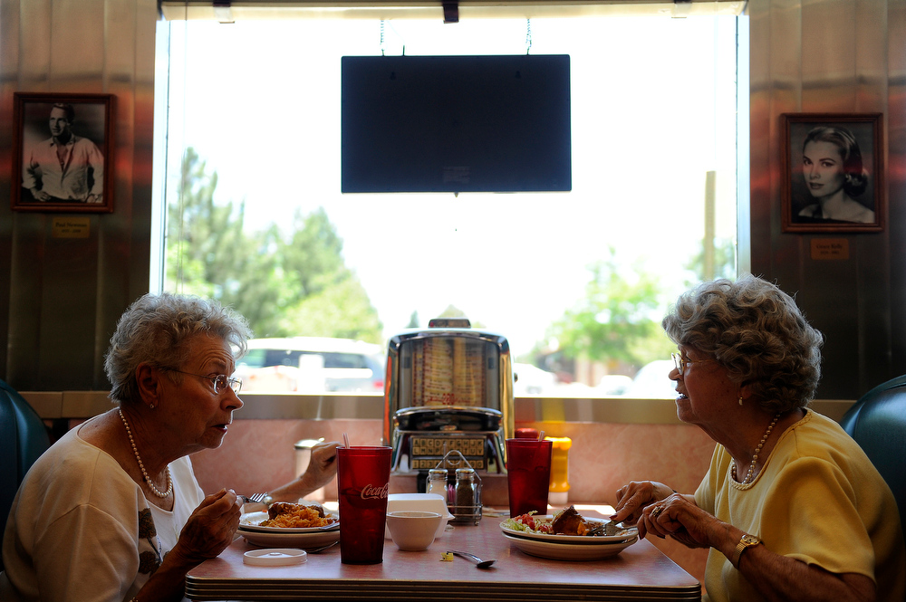 . Marcy Buchmann, left, and Robie Casey chat over lunch at Rosie\'s Diner in Aurora, Colorado on June 19, 2014. Rosie\'s Diner serves traditional American fare in a classic diner setting. (Photo by Seth McConnell/The Denver Post)