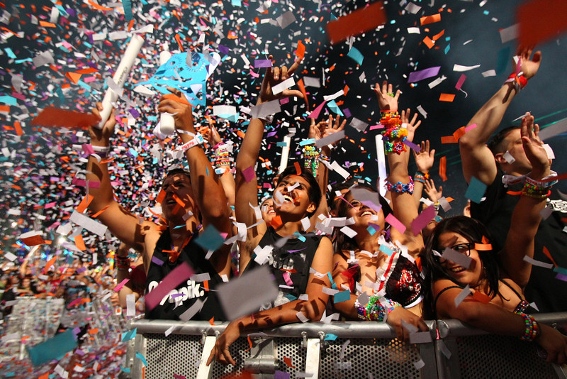 . Festival-goers watch Steve Angello at Kinetic Field as confetti goes off at the Electric Daisy Carnival at the Las Vegas Motor Speedway in the early hours of Monday, June 24, 2013, in Las Vegas. (AP Photo/Las Vegas Review-Journal, Chase Stevens)