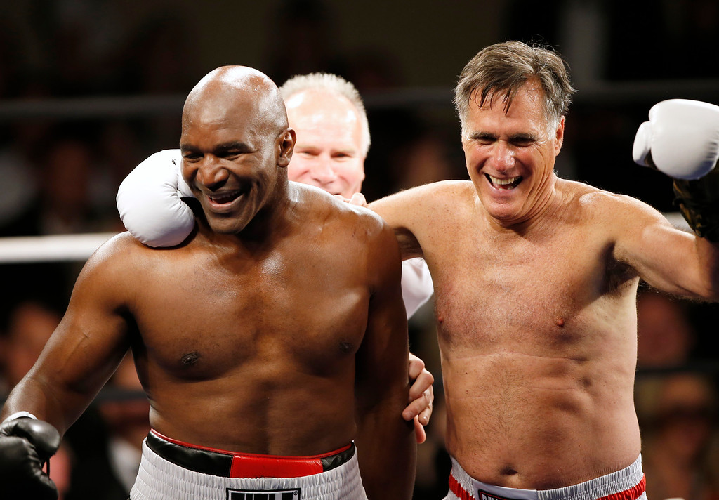 ". Evander Holyfield celebrates his win over Mitt Romney during a charity boxing event on May 15, 2015 in Salt Lake City, Utah. The event was held to raise money for  ""Charity Vision\"" a charity that aims to restore sight to the blind and visually impaired. (Photo by George Frey/Getty Images)"