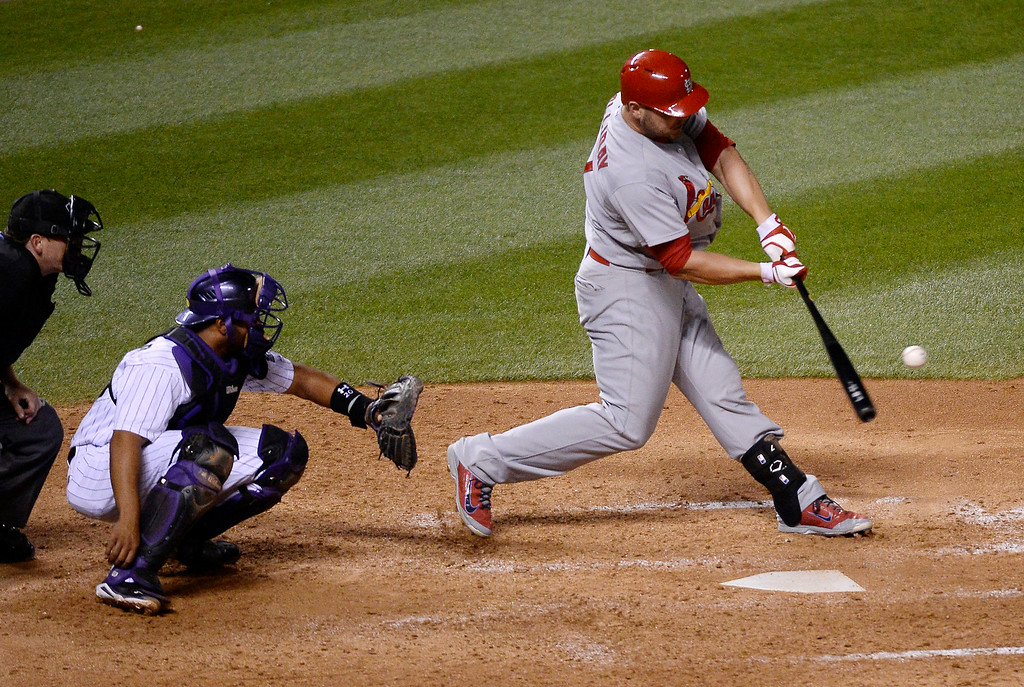 . DENVER, CO - JUNE 24: St. Louis Cardinals left fielder Matt Holliday (7) hits a single to left field during the seventh inning off of Colorado Rockies starting pitcher Jorge De La Rosa (29) June 24, 2014 at Coors Field. (Photo by John Leyba/The Denver Post)