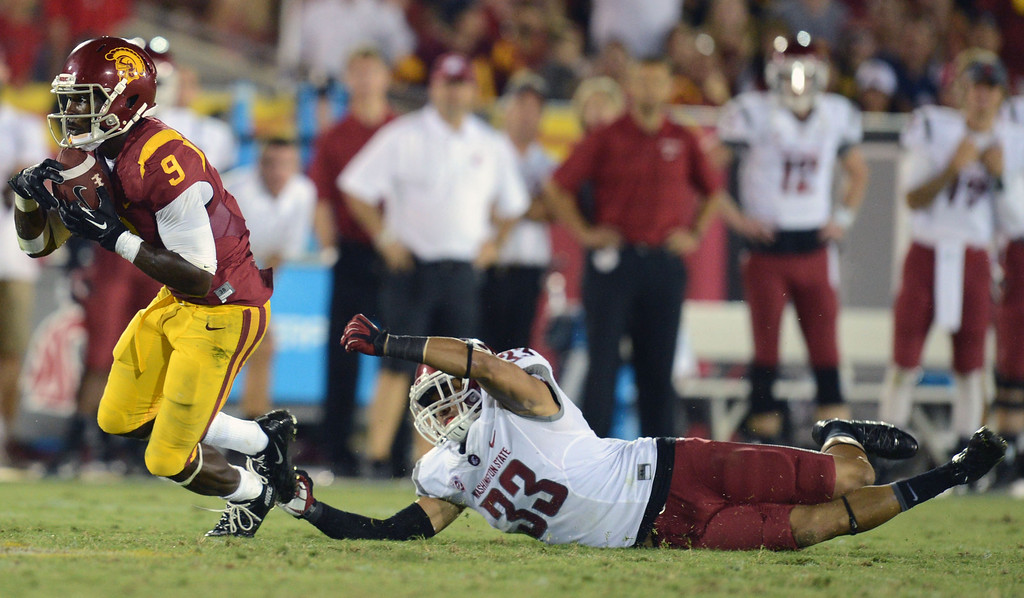 . USC\'s Marqise Lee #9 breaks away from Washington State\'s Tana Pritchard #33 during their game at the Los Angeles Memorial Coliseum  Saturday, September 7, 2013. Washington State beat USC10-7. (Photo by Hans Gutknecht/Los Angeles Daily News)