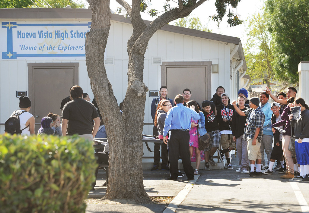 ". Students meeting in front of the school, Nueva Vista High School, to discuss the possible closing and moving to Bassett High School. The Bassett Unified School Board at Thursday�s meeting will discuss relocating its Nueva Vista High continuation/alternative school back to the Bassett High campus in the 2013-14 school year in order to provide a more cohesive learning environment.  School board member Laura Santos is opposed to the plan since the district spent $1 million to renovate the Nueva Vista campus. It�s unclear what would become of that site. Santos held a  rally with parents and students who oppose the move  Wednesday, April 17, 2013. .""Along with losing an excellent superintendent and terminating an award winning choir and music program, Santos sees this as part of a series of recent bad decisions,\"" Santos said (SGVN/Photo by Walt Mancini)"